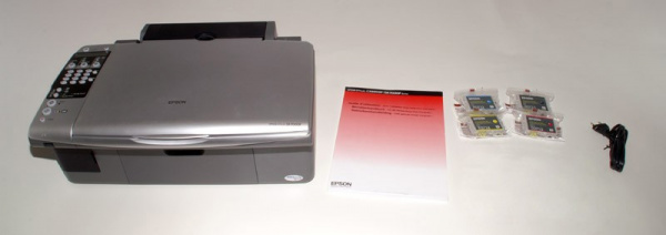 Epson Stylus DX7000F: Cartridges, manual, driver-CD, TAE-cable.